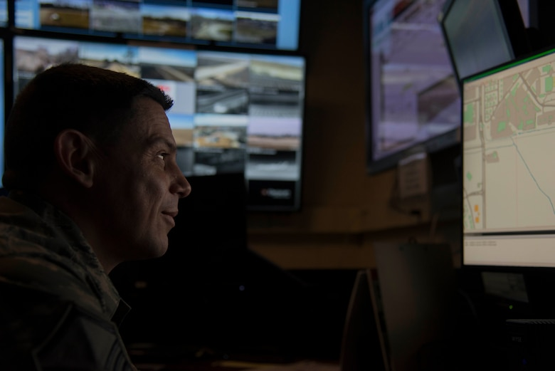Master Sgt. Aron Luna, 375th Security Forces Squadron logistics superintendent, surveys a map of the base on Feb. 25, 2019 at Scott Air Force Base, Illinois. Once the office space is converted to the Emergency Communications Center, Fire Fighters and Security Forces members, will work side by side in the Emergency Communications Center. (U.S. Air Force Photo by Airman 1st Class Kristin Savage)