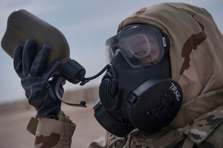 A U.S. Air Force Airman of the 379th Expeditionary Civil Engineer Squadron (ECES) emergency management office, hydrates during a joint decontamination exercise Feb. 22, 2019, at Al Udeid Air Base, Qatar. U.S. Air Force and Army participants from the 379th Expeditionary Civil Engineer Squadron and the 1st Battalion, 43rd Air Defense Artillery regiment, 11th ADA Brigade, shared Chemical, Biological, Radiological, Nuclear, and high yield explosives (CBRNE) best practices, and tested their response proficiency during the training. The event was the conclusion of a four phase training curriculum. (U.S. Air Force photo by Tech. Sgt. Christopher Hubenthal)