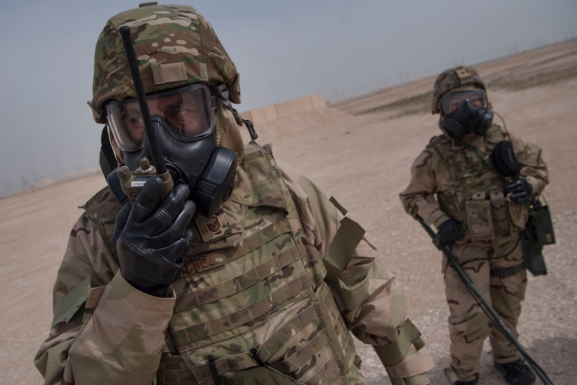 U.S. Air Force Master Sgt. Brett Sanchez, 379th Expeditionary Civil Engineer Squadron emergency management Chemical, Biological, Radiological, Nuclear, and high yield explosives (CBRNE) response NCO in charge, communicates with a radio alongside U.S. Army Pfc. Diamond Her, 1st Battalion, 43rd Air Defense Artillery (ADA) regiment, 11th ADA Brigade unit supply specialist, during a ground survey as part of a joint decontamination exercise Feb. 22, 2019, at Al Udeid Air Base, Qatar. U.S. Air Force and Army participants from the 379th ECES and the 1-43rd ADA, shared Chemical, Biological, Radiological, Nuclear, and high yield explosives (CBRNE) best practices, and tested their response proficiency during the training. The event was the conclusion of a four phase training curriculum. (U.S. Air Force photo by Tech. Sgt. Christopher Hubenthal)