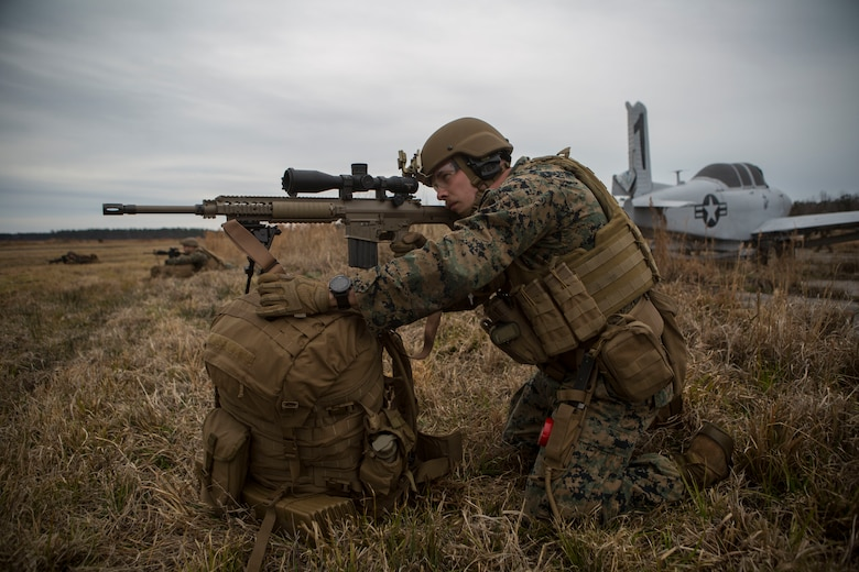 A Marine provides security during a simulated airfield occupation scenario on Camp Lejeune, North Carolina Feb. 19, 2019. The exercise was conducted to certify ground force airfield security procedures as a composited Marine Air- Ground Task Force. The Marine is with 1st Battalion, 8th Marine Regiment, 24th Marine Expeditionary Unit. (U.S. Marine Corps photos by Lance Cpl. Larisa Chavez)