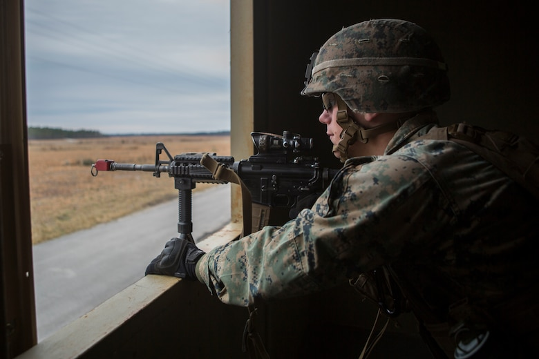 A Marine posts security during a simulated airfield occupation and security scenario on Camp Lejeune, North Carolina Feb. 19, 2019. The exercise was conducted to increase ground force response procedures proficiency and enhance security procedures as a composited Marine Air Ground Task Force. The Marine is with 1st Battalion, 8th Marine Regiment. (U.S. Marine Corps photos by Lance Cpl. Larisa Chavez)