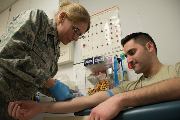 U.S. Air Force Maj. Devin Conway, a clinical nurse at the 179th Airlift Wing, Mansfield, Ohio, performs a blood draw at the 179th AW, Feb. 9, 2019. Conway has served in the Air Force in the medical field for 19 years. (U.S. Air National Guard photo by Senior Airman Megan Shepherd)