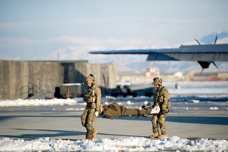 U.S. Air Force Airmen assigned to the 455th Expeditionary Aeromedical Evacuation Squadron participated in a training exercise with Airmen from the 83rd Expeditionary Rescue Squadron, Feb. 21, 2019. Airmen simulated the process of caring for individuals from point of injury until they were cared for in the air and transported to a medical facility. (U.S. Air Force photo by Senior Airman Rito Smith)