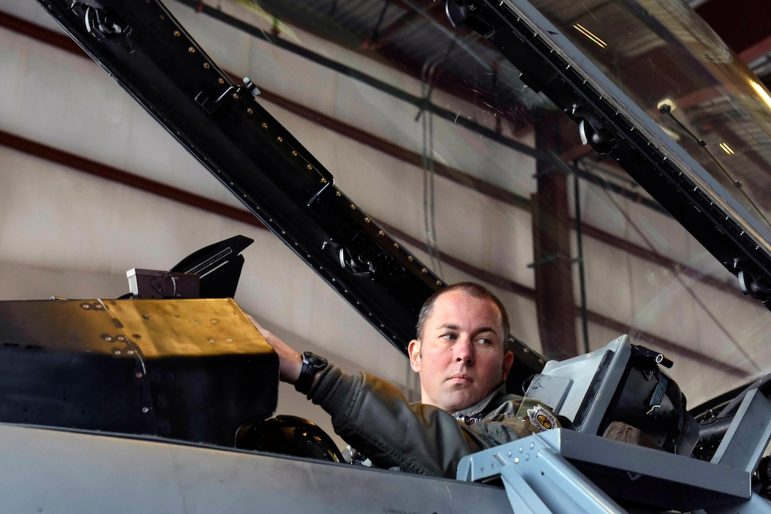 Air Force Lt. Col. Jason Halvorsen, a pilot with the District of Columbia Air National Guard's Aerospace Control Alert Detachment, goes through a pre-flight check in an F-16 Fighting Falcon aircraft during a training event at Joint Base Andrews, Maryland, Dec. 19, 2018. Halvorsen is one of several pilots with the detachment, which is tasked with keeping the Washington, D.C., area safe from airborne threats. The ACAD has responded to more than 6,200 alert events since its formation in the aftermath of the 9/11 attacks. (U.S. Air Force photo by Tech. Sgt. Erich B. Smith)