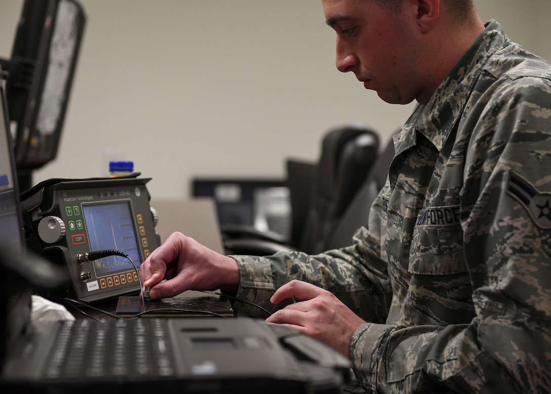 U.S. Air Force Airman 1st Class Branden Alderiso, 1st Maintenance Squadron non-destructive inspection journeyman uses ultrasonic test equipment at Joint Base Langley-Eustis, Virginia, Feb. 15, 2019. A team of instructors traveled from Ogden Air Logistics at Hill Air Force Base, Utah, to conduct the week-long NDI training course to revitalize non-destructive inspection skills readiness. (U.S. Air Force photo by Airman 1st Class Monica Roybal)