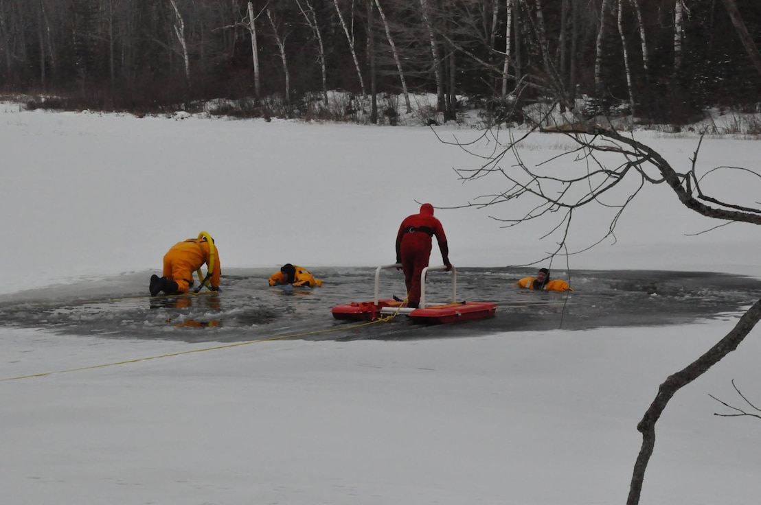 Firefighters train for readiness in Ice and Cold water rescue.