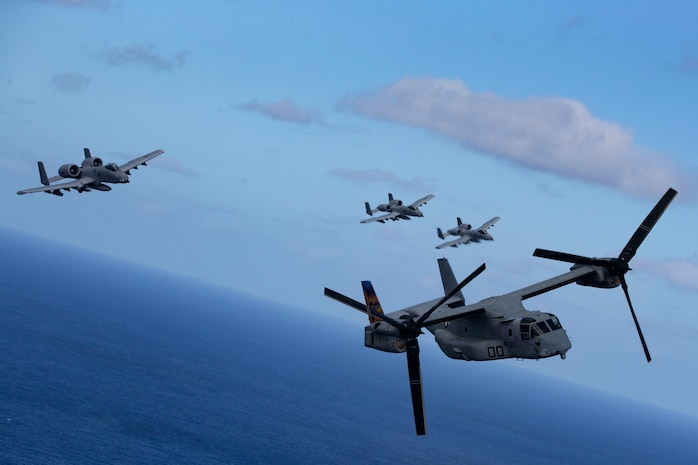U.S. Air Force A-10 Thunderbolt II aircraft assigned to the 442nd Fighter Wing, Whiteman Air Force Base, Missouri, escort MV-22B Osprey assigned to Marine Medium Tiltrotor Squadron 268, Hawaii, Feb. 26, 2019. U.S. Marines with Weapons Company, 2nd Battalion, 3rd Marine Regiment and VMM-268 along with A-10 Thunderbolt II conducted training consisting of a simulated tactical recovery of aircraft personnel scenario and a combat search and rescue scenario.