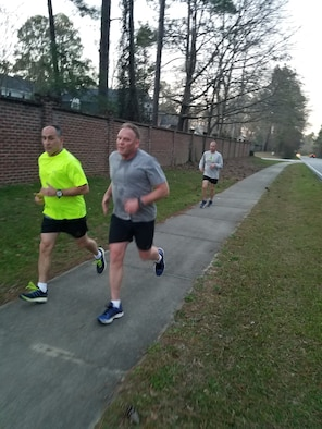 The Red White and Blue running group members race on their four-mile run in Sumter, S.C., Feb. 25, 2019.