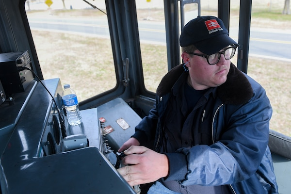 William Grimes, 733rd Logistics Readiness Squadron, Transportation section, utility rail branch locomotive engineer, steers a railcar at Joint Base Langley-Eustis, Virginia, Feb. 15, 2019. The JBLE utility shop plays an integral role in Joint Logistical over the Sea operations where causeways, vehicles and equipment can easily be transported across the nation.(U.S. Air Force photo by Senior Airman Derek Seifert)