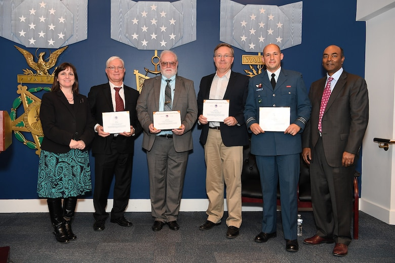 The Legacy Fleet Drag Reduction Program was awarded the Technical Cooperation Program (TTCP) Team Award Feb. 6 during a ceremony held at the Pentagon. AFRL's Dennis Carter, Senior Aerospace Engineer with the Aerospace Systems Directorate, and other members of his team, including John Carr and Tony Lorang from Boeing, and Maj. Greg Givogue from the Royal Canadian Air Force, were presented the award for efforts in reducing the aerodynamic drag of the C-130 and C-17 aircraft. This was a joint effort between Australia, Canada, the United Kingdom and the United States, potentially reducing the fuel burned by the United States Air Force by $30 million annually. Pictured (left to right): Mary J. Miller, Principal Deputy Director of Defense Research and Engineering for Research and Development; Carr, Carter, Lorang, Givogue and Dr. Jagadeesh Pamulapati, Director Laboratories. (U.S. Army photo by Mr. Leroy Council)