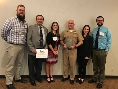 Naval Surface Warfare Center, Crane Division (NSWC Crane) was recognized as Employer of the Year for creating a quality internship program within the Hoosier State. NSWC Crane received this award in the nonprofit category at the Indiana Chamber of Commerce Indiana INTERNnet 2019 IMPACT Awards in Carmel, Indiana on February 26, 2019.