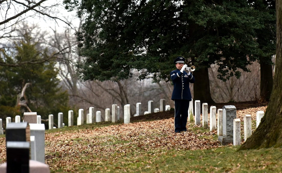 Bugler performs Taps at funeral service