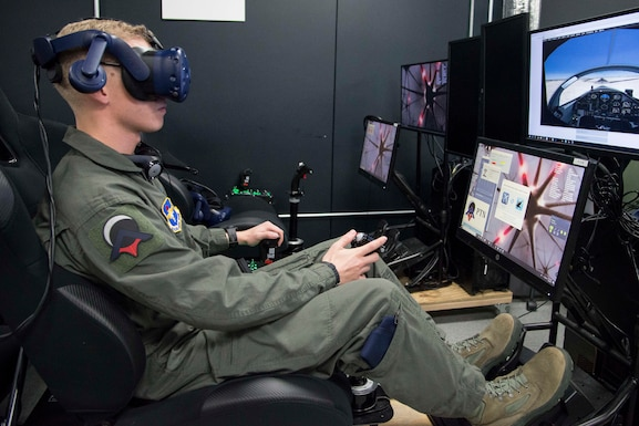 Airman First Class Shane Stewart, Pilot Training Next student, trains on a virtual reality flight simulator at the Armed Forces Reserve Center in Austin, Texas, Feb. 5, 2019. The instruction in this second version is shaped from the success of and lessons learned from the first PTN program, where 13 officers graduated in June 2018 and progressed to advanced training across multiple platforms. (U.S. Air Force photo by Sean M. Worrell)
