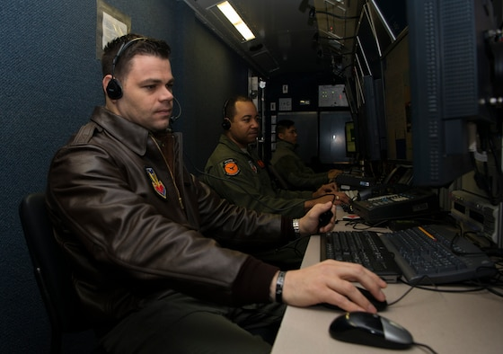 Master Sgt. Mike, 12th Reconnaissance Squadron RQ-4 Global Hawk pilot, and Tech. Sgt. Robert, 12th RS RQ-4 sensor operator, simulate flying operations in a mission control element