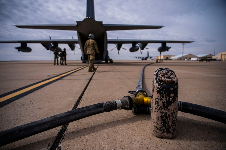 A refueling hose splits in two directions out of the back of a MC-130J during the start of Forward Area Refueling Point training for F-35A aircraft at Cannon Air Force Base, N.M., Feb. 27, 2019. This was the first time FARP training was conducted by an MC-130J for the F-35A aircraft as it expands its reach and capabilties. (U.S. Air Force photo by Staff Sgt. Luke Kitterman)