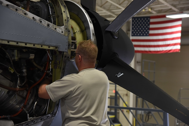 Tech. Sgt. Christopher Botts, 403rd Maintenance Squadron aircraft engine mechanic, works to remove a turbine vibration sensor from a WC-130J engine Jan. 13, 2019. Once removed, Botts will inspect the sensor, thoroughly clean it and reconnect it. (U.S. Air Force photo by Senior Airman Kristen Pittman)
