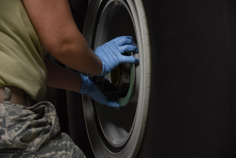 Senior Airman Landis Lee, 403rd Maintenance Squadron crew chief, prepares a tire for removal from a WC-130J  Jan. 13, 2019. This is a requirement that is performed during the routine inspections required to the maintain the aircraft's capabilities. (U.S. Air Force photo by Senior Airman Kristen Pittman)