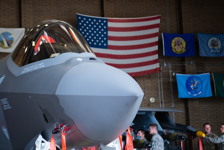 The F-35A Lightning II sits in a hangar loaded with dummy external munitions, Feb. 13, 2019 at Luke Air Force Base, Ariz. The F-35 brings together strategic international partnerships and alliances, where it will employ a variety of US and allied weapons. (U.S. Air Force photo by Airman 1st Class Aspen Reid)