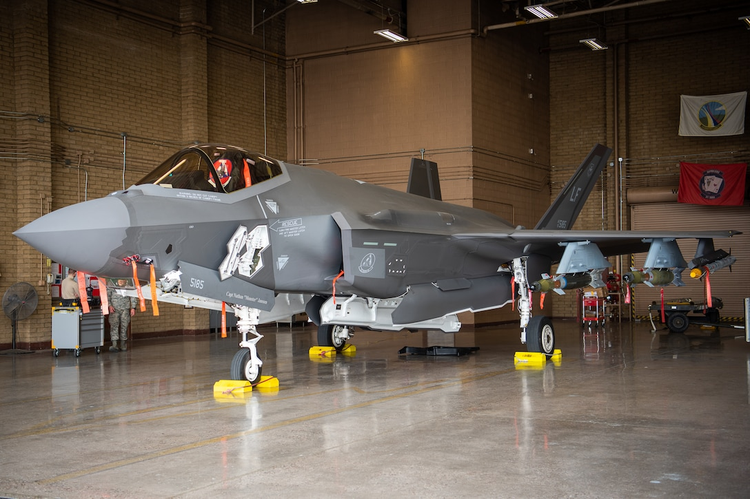 The F-35A Lightning II sits in a hangar loaded with dummy external munitions, Feb. 13, 2019 at Luke Air Force Base, Ariz. After completing the external pylon installation training, the weapons loading standardization crew, a team of three Airmen, became the first team at Luke to be certified on external GBU-12 bomb and AIM-9 missile loading. (U.S. Air Force photo by Airman 1st Class Aspen Reid)