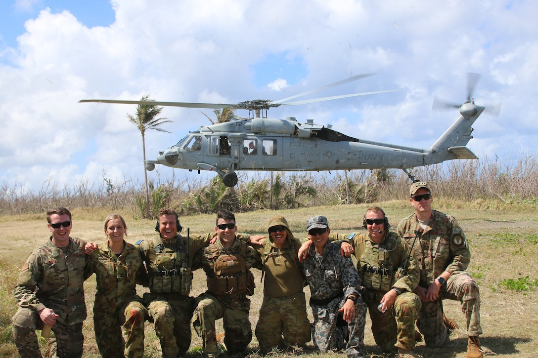 Service members from the United States, Royal Australian Air Force, and the Japan Air Self-Defense Force pose for a photo after an aeromedical evacuation exercise during Cope North 2019 Feb. 27, 2019, at Tinian, Commonwealth of the Northern Marianas. Service members from the U.S., Royal Australian Air Force, and the Japan Air Self-Defense Force exercised their Humanitarian Assistance and Disaster Relief skills together on Tinian by providing emergency medical care and secure transportation for simulated patients. (Courtesy photo)