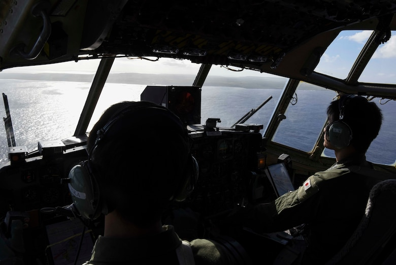Service members with the Japan Air Self-Defense Force stationed out of the 401st Squadron at Komaki Air Base, Aichi Prefecture, Japan, fly to the island of Tinian for an exercise during Cope North 2019 Feb. 27, 2019. Service members from the U.S., Royal Australian Air Force, and the Japan Air Self-Defense Force exercised their Humanitarian Assistance and Disaster Relief skills together on Tinian by providing emergency medical care and secure transportation for simulated patients. (U.S. Air Force photo by Tech. Sgt. Jake Barreiro)