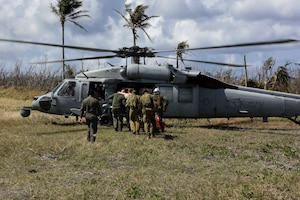 Service members from the United States, Royal Australian Air Force, and the Japan Air Self-Defense Force transfer simulated injured personnel to a MH-60 helicopter with the U.S. Navy's Helicopter Sea Combat Squadron 25 during an exercise for Cope North 2019, Feb. 27, 2019, at Tinian, Commonwealth of the Northern Marianas. Service members from the U.S., Royal Australian Air Force, and the Japan Air Self-Defense Force exercised their Humanitarian Assistance and Disaster Relief skills together on Tinian by providing emergency medical care and secure transportation for simulated patients.  (U.S. Air Force photo by Tech. Sgt. Jake Barreiro)