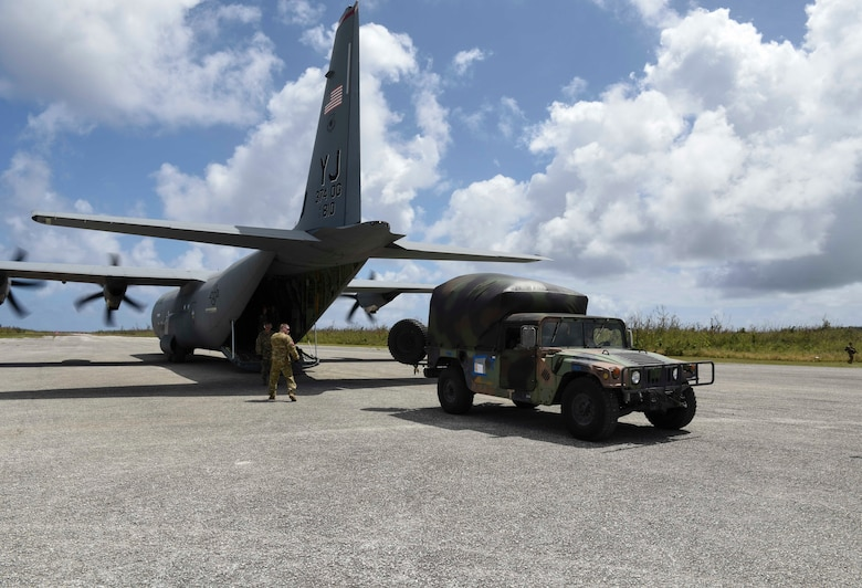 United States service members transfer personnel with simulated injuries onto a C-130J from Yokota Air Base, Japan, during an exercise for Cope North 2019, Feb. 27, 2019, at Tinian, Commonwealth of the Northern Marianas. On Feb. 27, service members from the U.S., Royal Australian Air Force, and the Japan Air Self-Defense Force exercised their Humanitarian Assistance and Disaster Relief skills together on Tinian by providing emergency medical care and secure transportation for simulated patients. (U.S. Air Force photo by Tech. Sgt. Jake Barreiro)