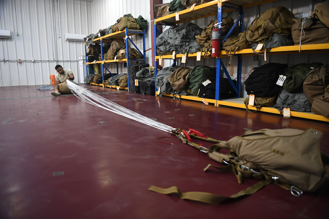 The 82nd Expeditionary Rescue Squadron aircrew flight equipment flight maintains parachutes for operations in East Africa. (Last names withheld for security purposes.)