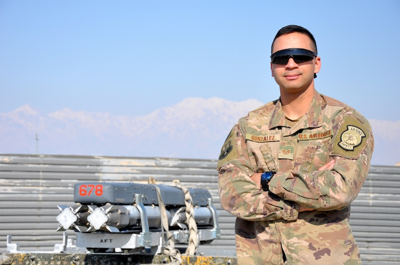 Staff Sgt. Tomas Gonzalez, 455th Air Expeditionary Wing weapons safety manager, stands in the flightline munitions holding area at Bagram Airfield, Afghanistan, Feb. 22, 2019.