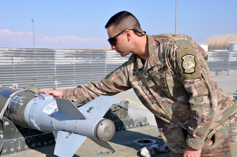 Staff Sgt. Tomas Gonzalez, 455th Air Expeditionary Wing weapons safety manager, inspects a GBU-54 laser joint directed attack munition at Bagram Airfield, Afghanistan, Feb. 22, 2019.