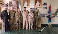 Members of the Qatar Emiri Air Force (QEAF) and the West Virginia National Guard pose for a photo Feb. 14, 2019, while touring the QEAF facilities at Al Udeid Air Base, Qatar. During a five-day tour, three members of the West Virginia Air National Guard's 130th and 167th Airlift Wings, as well as the State Partnership Program Coordinator for Qatar,  were provided insight into the operations of Qatar's air force and met with key QEAF leaders for discussion on interoperability of forces and future engagement opportunities. (Courtesy photo)