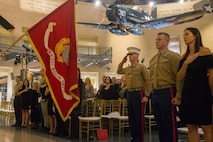 U.S. Marine Lt. Col. Eric Grunke, right, salutes the colors during the Marine Attack Squadron (VMA) 231 100 year anniversary celebration at Quantico, Virginia, Feb. 23, 2019.