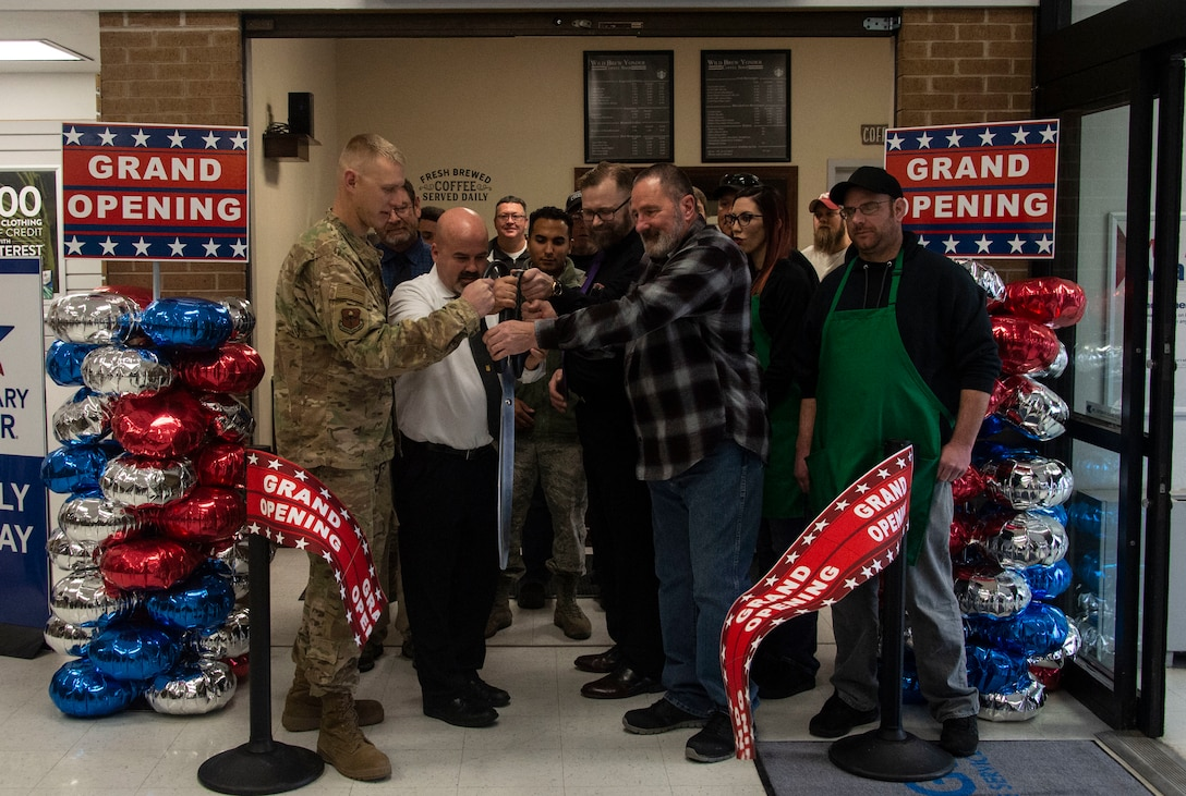 Members of the 97th Air Mobility Wing responsible for helping build the new Wild Brew Yonder coffee shop cut the grand opening ribbon, Feb. 29, 2019 at Altus Air Force Base, Okla.