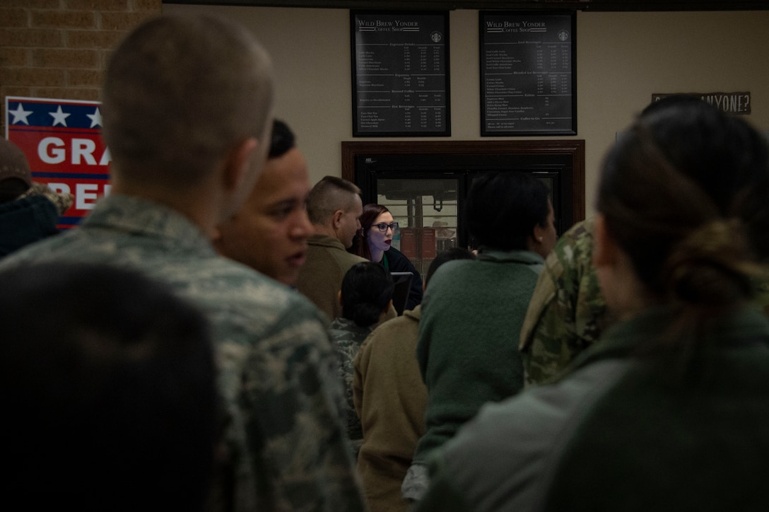 Airmen from the 97th Air Mobility Wing line up to order beverages from the new Wild Brew Yonder coffee shop, Feb. 29, 2019 at Altus Air Force Base, Okla.