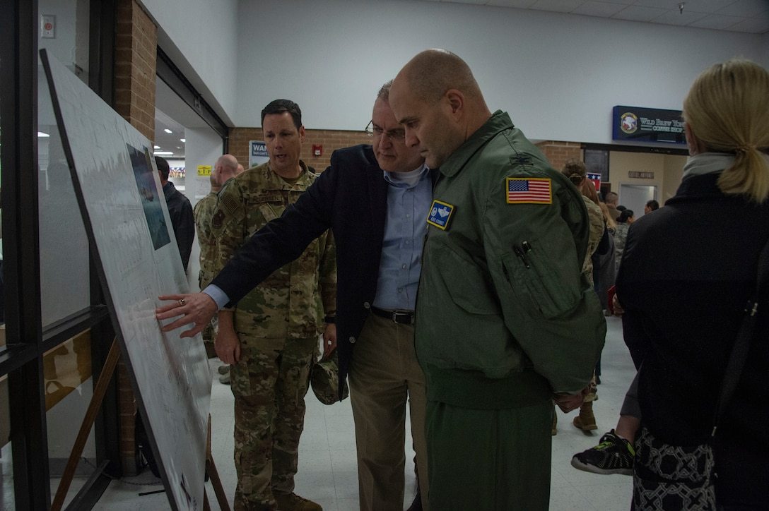 Don Walter Jr., Exchange general manager for Fort Sill, Okla./Sheppard Air Force Base/Altus AFB, shows U.S. Air Force Col. Eric Carney, 97th Air Mobility Wing commander and Col. Robert Pedersen, 97th Mission Support Group commander the expansion plans for the Base Exchange, Feb. 29, 2019 at Altus Air Force Base, Okla.