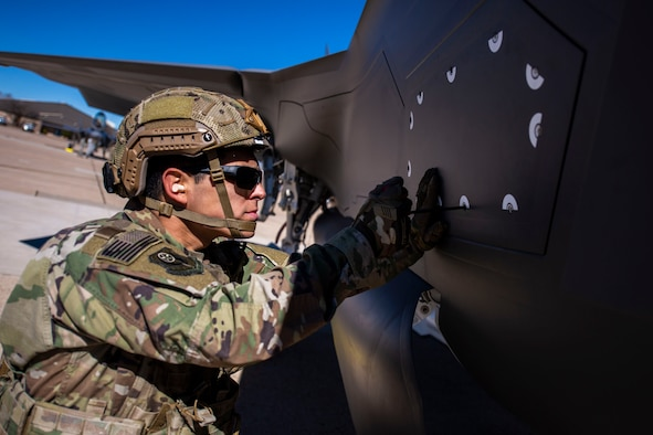 An Airman from the 27th Special Operations Logistics Readiness Squadron replaces a panel after refueling an F-35A aircraft during Forward Area Refueling Point training Cannon Air Force Base, N.M., Feb. 26, 2019. This was the first time FARP training was conducted by an MC-130J for the F-35A aircraft as it expands its reach and capabilties. (U.S. Air Force photo by Staff Sgt. Luke Kitterman)