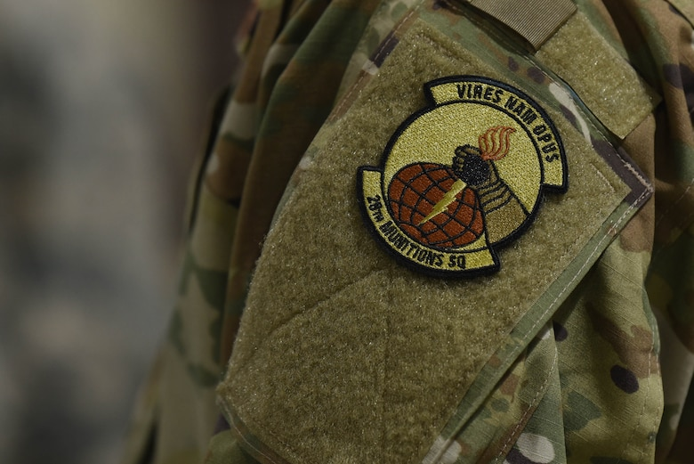 The patch of the 28th Munitions Squadron is proudly worn by a Raider Airman during a qualifying round for the second annual Air Force Combat Operations Competition on Ellsworth Air Force Base, S.D., Feb. 5, 2019. The competition is Air Force-wide and is used to determine the best of the best in munitions operations. (U.S. Air Force photo by Airman John Ennis)