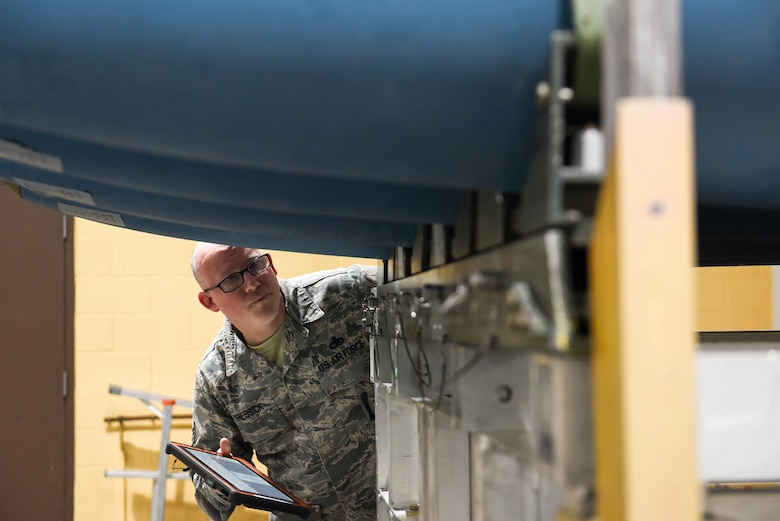 Master Sgt. James Gressick, a U.S. Air Force Global Strike Command Conventional Munitions Division command munitions manager, inspects the completed bombs during the qualifying round of the second annual Air Force Combat Operations Competition on Ellsworth Air Force Base, S.D., Feb. 5, 2019. The competition is Air Force-wide and is used to determine the best of the best in munitions operations. (U.S. Air Force photo by Amn John Ennis)