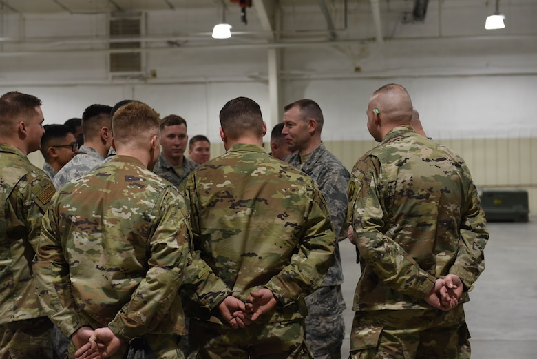 The commander of the 28th Munitions Squadron, Maj. Adam Pierce, addresses the team after they completed the qualifying round of the second Air Force Combat Operations Competition on Ellsworth Air Force Base, S.D., Feb. 5, 2019. The competition is Air Force-wide and is used to determine the best of the best in munitions operations. (U.S. Air Force photo by Airman John Ennis)