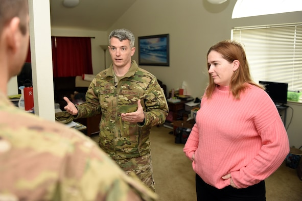 U.S. Air Force Tech. Sgt. Thomas Decker, 60th Aerial Port Squadron NCO in charge of bunker operations, and his wife, Tracy, talk with U.S. Air Force Maj. Philip Lere, 60th APS operations officer, about issues facing their home during a review of their housing situation, Feb. 25 at Travis Air Force Base, California. The housing review comes as an Air Force-wide effort to take a proactive approach to resolveing any potential or chronic issues for facing housing residents. (U.S. Air Force photo by Airman 1st Class Christian Conrad)