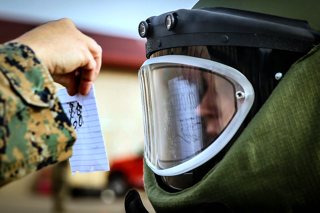U.S. Marine Corps Sgt. Joseph Hamilton, military police officer with Bravo Company, 1st Law Enforcement Battalion, I Marine Expeditionary Force Information Group answers math trivia questions while wearing an Explosive Ordnance Disposal-9 Advanced Bomb Suit during an EOD lateral move screening at Marine Corps Base Camp Pendleton, California, Feb. 26, 2019.  Hamilton and other EOD lateral move candidates conducted a bomb suit agility test to evaluate their capability to overcome obstacles, analyze situations and maneuver tactically while wearing the suit.