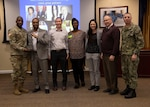 DLA Director Army Lt. Gen. Darrell Williams (left) and Navy Command Master Chief Shaun Brahmsteadt (far right) present the 5-person DLA team with a special emphasis program award for their win during the Black History Month trivia challenge, Feb. 27.