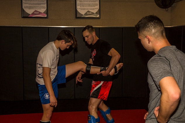U.S. Marine Corps Sgt. Gianni Cappasso, an imagery analysis specialist assigned to Marine Fighter Attack Squadron 122, teaches Marines aboard Marine Corps Air Station (MCAS) Yuma Muy Thai techniques at the station gym on MCAS Yuma, Ariz., Feb. 13, 2019. Cappasso offers martial arts classes to Marines to provide them with the opportunity to use their spare time to become more deadly war-fighters and maintain a high level of physical fitness. (U.S. Marine Corps photo by Cpl. Isaac D. Martinez)