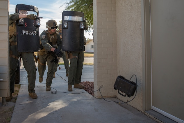 U.S. Marines with the Provost Marshal's Office (PMO), Headquarters and Headquarters Squadron (H&HS), Marine Corps Air Station (MCAS) Yuma, conduct Special Reaction Team (SRT) training on MCAS Yuma, Ariz., Feb. 25, 2019. The SRT is comprised of military police personnel trained to give an installation commander the ability to counter or contain a special threat situation surpassing normal law enforcement capabilities. (U.S. Marine Corps photo by Sgt. Allison Lotz)