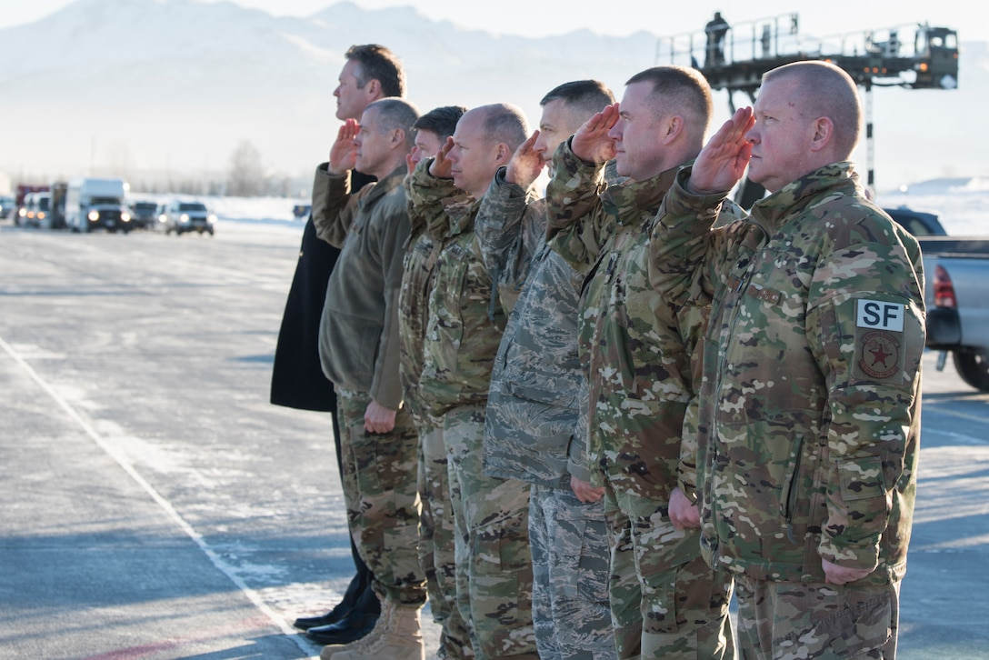 Joint Base Elmendorf-Richardson senior leadership salutes while Alaska Gov. Michael Dunleavy, far left, greets President Donald Trump following his arrival to JBER, Alaska, Feb. 28, 2019. The president talked to more than 100 personnel while his plane refueled before continuing his travel to Joint Base Andrews, Maryland.