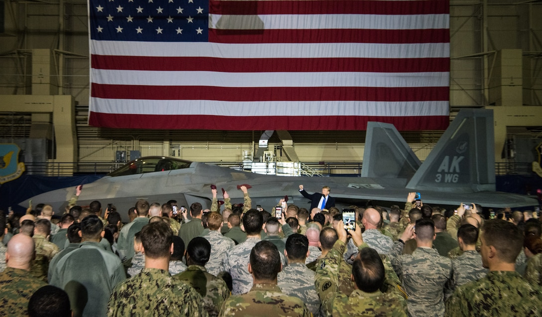 More than 100 Airmen, Sailors, Soldiers, Marines, and Coast Guardsmen welcome President Donald Trump at Joint Base Elmendorf-Richardson, Alaska, Feb. 28, 2019. The president was at the base to meet with service members after returning from a summit in Hanoi, Vietnam.