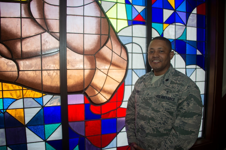 U.S. Air Force Chaplain Lt. Col. Steve Dabbs, the wing Chaplin of the 97th Air Mobility Wing, stands by the Chapels stained glass, Feb. 25, 2019, at Altus Air Force Base, Okla