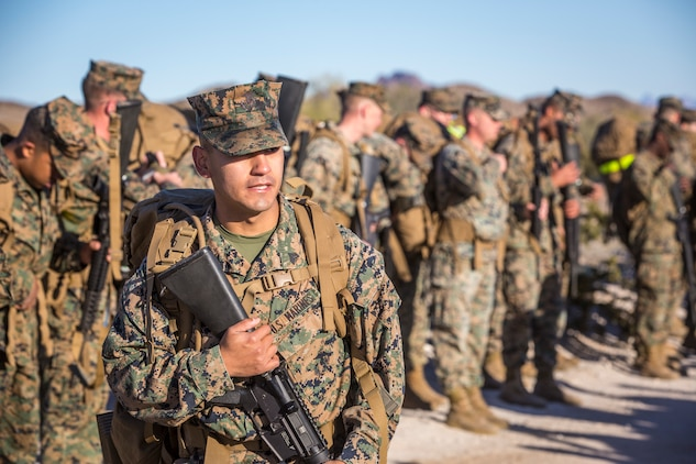 """U.S. Marines and Sailors stationed on Marine Corps Air Station (MCAS) Yuma participate in """"Operation Backbone"""" in Yuma, Ariz., Feb. 7, 2019. Operation Backbone is a quarterly unit exercise meant to strengthen the warrior's spirit in the non-commisioned officers (NCOs) and promote cohesion between them. The exercise consisted of a hike with the Headquarters and Headquarters Squadron (H&HS)  commanding officer and acting sergeant major, several classes, and a warriors night. Classes included simulated room clearing training, terrain model training, improvised explosive devices (IED) training, and the Family Advocacy Program on station sent out a representative to talk to the NCOs about leadership. (U.S. Marine Corps photo by Cpl. Isaac D. Martinez)"""