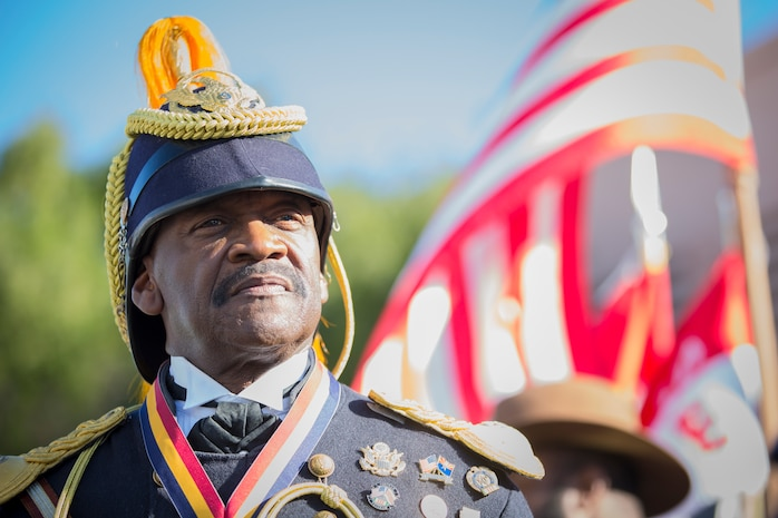 A Civilian with the Buffalo Soldiers of the Arizona Territory and Ladies and Gentlemen of the Regiment pose for a portrait photo during Yuma Military Appreciation Day in Downtown Historic Yuma on Feb. 16, 2019. Military Appreciation Day is held to show the importance of the relationship between the City of Yuma and our service members and veterans. (U.S. Marine Corps photo by Sgt. Allison Lotz)