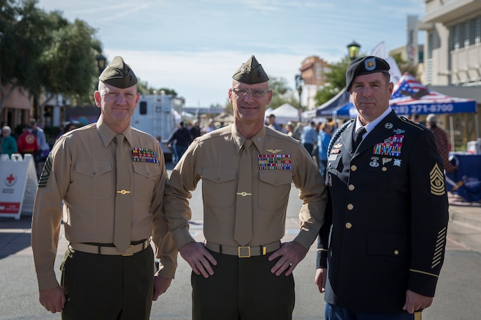 U.S. Marine Corps Col. David A. Suggs (center), commanding officer, Marine Corps Air Station (MCAS) Yuma, Sgt. Maj. David M. Leikwold (left), sergeant major, MCAS Yuma, and U.S. Soldier Sgt. Maj. Jamathon K. Nelson, sergeant major, Yuma Proving Ground pose for a group photo during Yuma Military Appreciation Day in Downtown Historic Yuma on Feb. 16, 2019. Military Appreciation Day is held to show the importance of the relationship between the City of Yuma and our service members and veterans. (U.S. Marine Corps photo by Sgt. Allison Lotz)